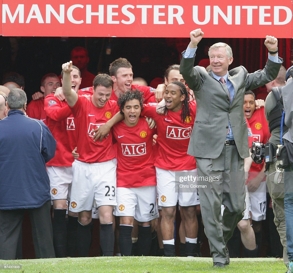 The Manchester United squad celebrates with the Premier League trophy after the Barclays Premier League match between Manchester United and Arsenal at Old Trafford on May 16 2009 in Manchester, England.