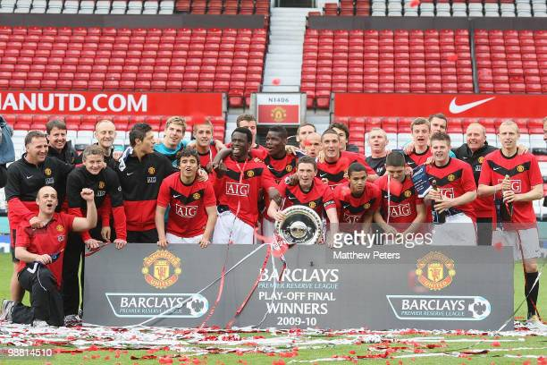 The Manchester United squad celebrates with the trophy after the Barclays Premier Reserve League PlayOff match between Manchester United Reserves and...