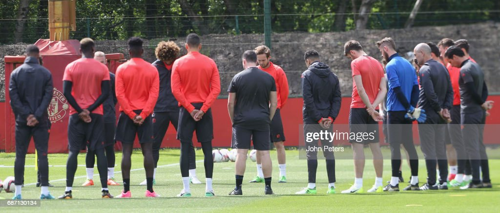 The Manchester United squad hold a minute's silence in honour of the victims of the attack at Manchester Arena ahead of a first team training session, ahead of the UEFA Europa League Final, at Aon Training Complex on May 23, 2017 in Manchester