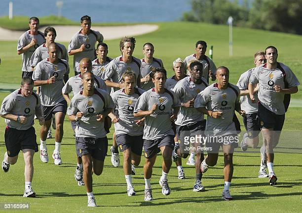 The Manchester United squad in action during a pre-season first team training session on 29 June 2005 in Vale do Lobo, Portugal.