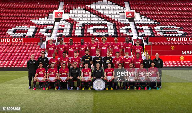 The Manchester United squad pose during the annual team photocall Back row Phil Jones Marcus Rashford Timothy FosuMensah Eric Bailly Chris Smalling...