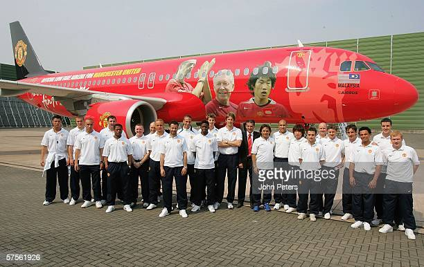 The Manchester United squad pose in front of the specially liveried Air Asia Airbus at Manchester Airport on May 9 2006 in Manchester England