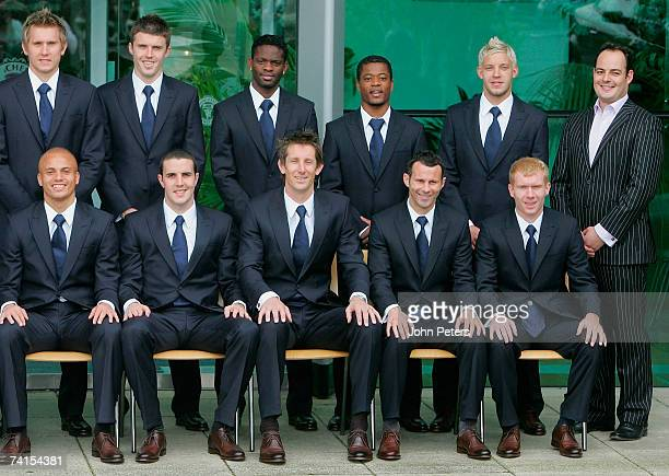 The Manchester United squad pose in their FA Cup Final suits designed by William Hunt at Carrington Training Ground on May 15 2007 in Manchester...