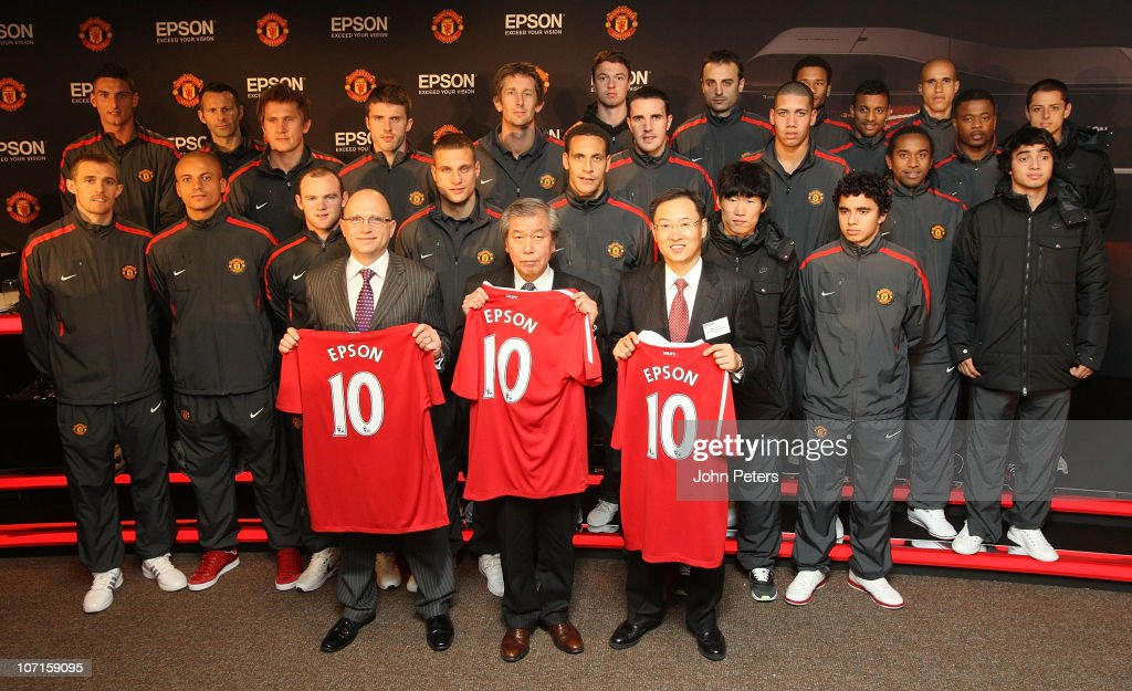 The Manchester United squad pose with representatives from Epson after a press conference to announce Epson as new club partners at Old Trafford on November 26, 2010 in Manchester, England.