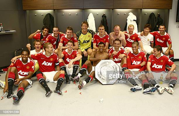 LONDON ENGLAND AUGUST 08 The Manchester United squad pose with the Community Shield Back Row Fabio Da Silva John O'Shea Michael Carrick Edwin van der...