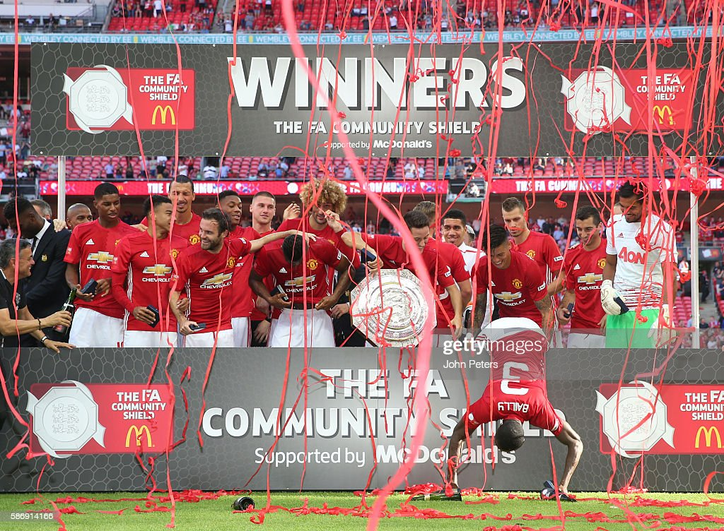 The Manchester United squad pose with the Community Shield trophy after the FA Community Shield match between Leicester City and Manchester United at Wembley Stadium on August 7, 2016 in London, England.