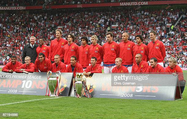 The Manchester United squad pose with the FA Barclays Premiership trophy and the UEFA Champions League trophy ahead of the preseason friendly match...