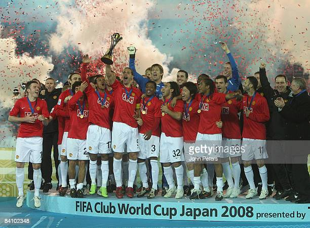 The Manchester United squad pose with the FIFA World Club Cup after the FIFA World Club Cup Final match between LDU Quito and Manchester United at...
