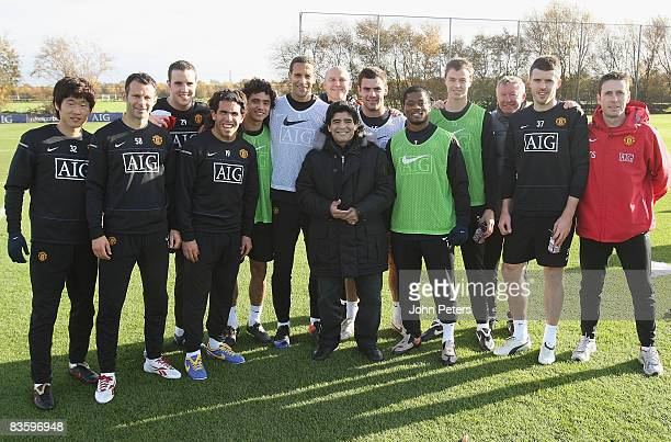 The Manchester United squad poss with Argentine national manager Diego Maradona during a First Team Training Session at Carrington Training Ground on...