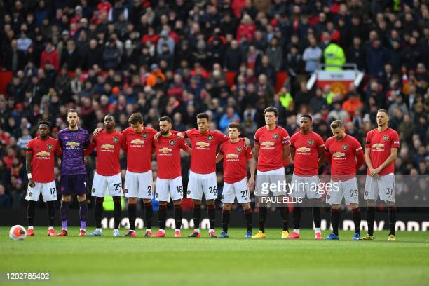 The Manchester United starting XI observe a silence in honour of the late Manchester United goalkeeper and Munich Air Disaster hero Harry Gregg...