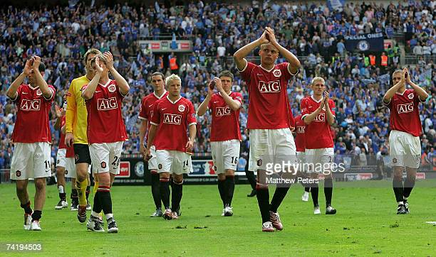 The Manchester United team applaud their fans after the FA Cup Final sponsored by EON between Manchester United and Chelsea at Wembley Stadium on May...
