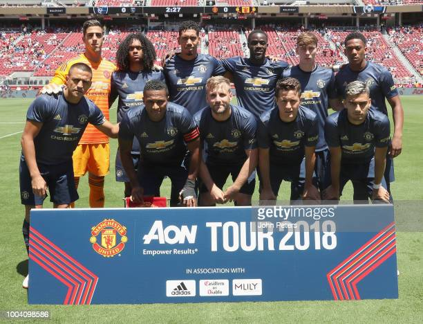 The Manchester United team Back Row LR Joel Pereira Tahith Chong Chris Smalling Eric Bailly James Garner Anthony Martial Front Row LR Alexis Sanchez...