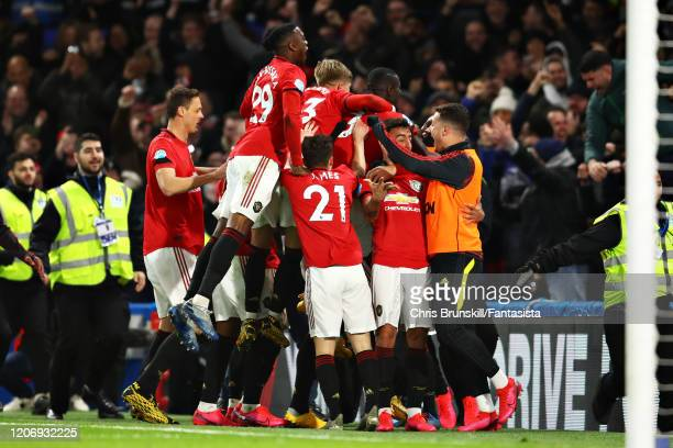 The Manchester United team celebrate after Harry Maguire of Manchester United scores his sides second goal during the Premier League match between...