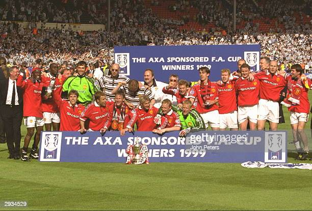 The Manchester United team celebrate after the FA Cup Final between Manchester United v Newcastle at Wembley Stadium on May 22 1999 in London...