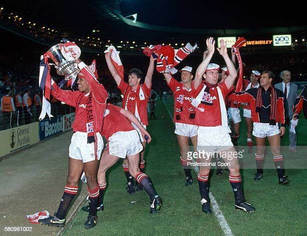 The Manchester United team celebrate after their victory in the FA Cup Final replay against Crystal Palace at Wembley Stadium on May 17 1990 in...