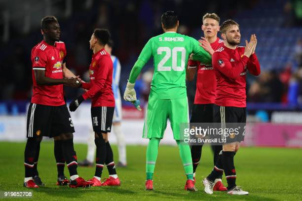 The Manchester United team celebrate after winning the Emirates FA Cup Fifth Round match between Huddersfield Town and Manchester United on February...
