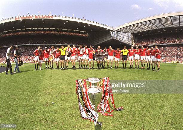 The Manchester United team celebrate on the pitch after the FA Premiership match between Manchester United v Tottenham Hotspur at Old Trafford on May...