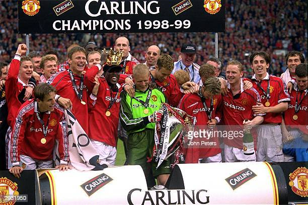 The Manchester United team celebrate on the pitch having been presented with the trophy after the FA Carling Premiership match between Manchester...