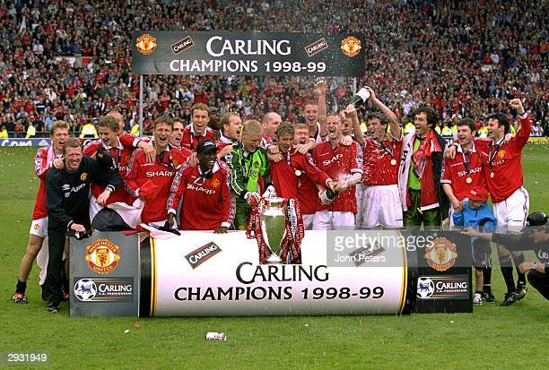 The Manchester United team celebrate on the pitch having won the title after the FA Carling Premiership match between Manchester United v Tottenham...
