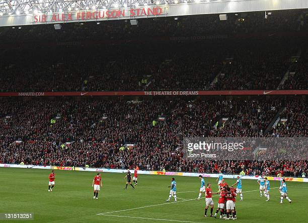 The Manchester United team celebrate Wes Brown of Sunderland scoring an own-goal during the Barclays Premier League match between Manchester United...