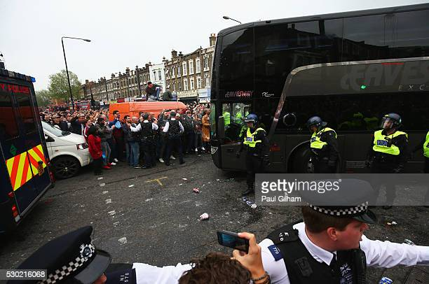 The Manchester United team coach attempts to make its way through the crowds prior to the Barclays Premier League match between West Ham United and...