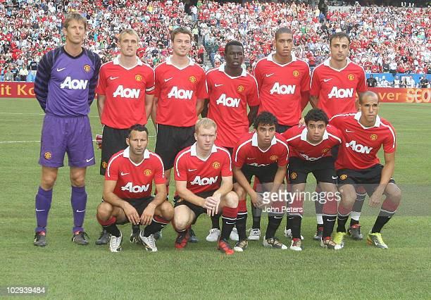 The Manchester United team Edwin van der Sar Darren Fletcher Jonny Evans Mame Biram Diouf Chris Smalling Dimitar Berbatov Front Row Ryan Giggs Paul...