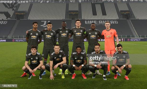 The Manchester United team line up ahead of the UEFA Europa League Round of 32 match between Real Sociedad and Manchester United at Allianz Stadium...