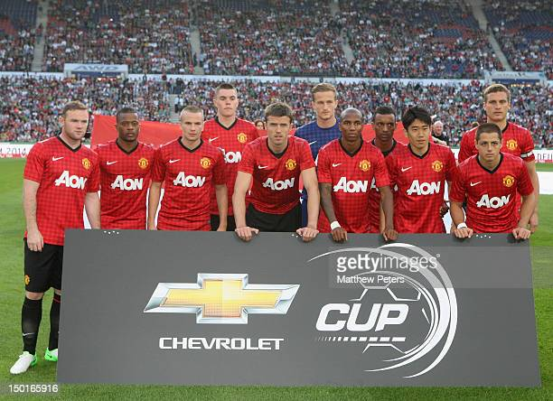 The Manchester United team line up Wayne Rooney, Patrice Evra, Tom Cleverley, Michael Keane, Michael Carrick, Anders Lindegaard, Ashley Young, Nani,...