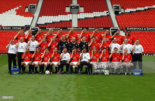 The Manchester United team line up with a white board for a sponsors logo at Old Trafford on August 8 in Manchester England