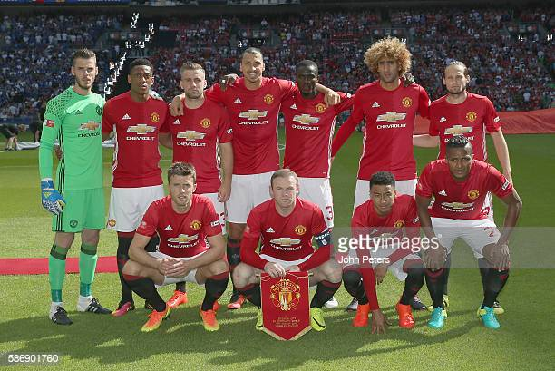 The Manchester United team lines up ahead of the FA Community Shield match between Leicester City and Manchester United at Wembley Stadium on August...