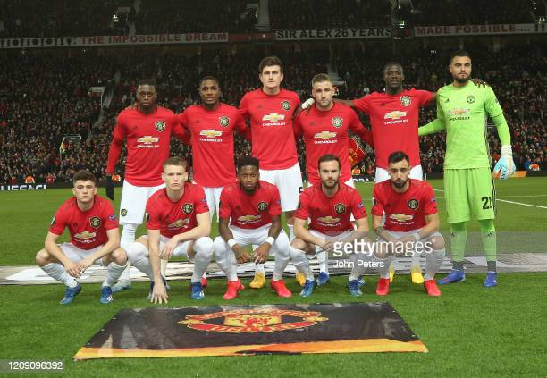 The Manchester United team lines up ahead of the UEFA Europa League round of 32 second leg match between Manchester United and Club Brugge at Old...