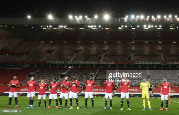 The Manchester United team lines up ahead of the UEFA Europa League Round of 32 match between Manchester United and Real Sociedad at Old Trafford on...