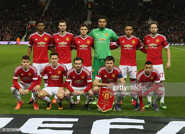 The Manchester United team lines up ahead of the UEFA Europa League match between Manchester United and FC Midtjylland at Old Trafford on February 25...
