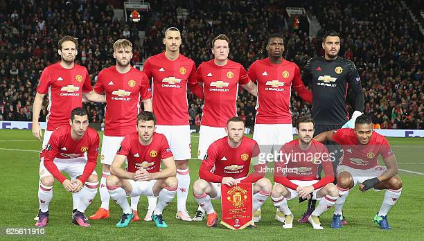 The Manchester United team lines up ahead of the UEFA Europa League match between Manchester United FC and Feyenoord at Old Trafford on November 24...