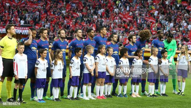 The Manchester United team lines up ahead of the UEFA Europa League Final match between Manchester United and Ajax at Friends Arena on May 24 2017 in...