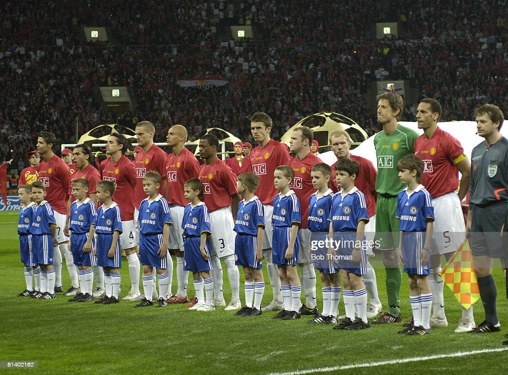 The Manchester United Team Line Up With Mascots Before The