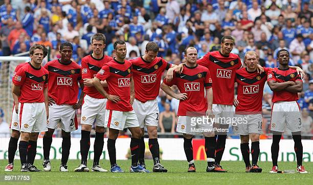 The Manchester United team look dejected as they watch the penalty shootout during the FA Community Shield match between Chelsea and Manchester...