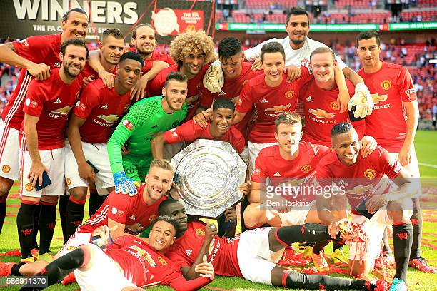 The Manchester United team pose for a photo with the Community Shield during The FA Community Shield match between Leicester City and Manchester...