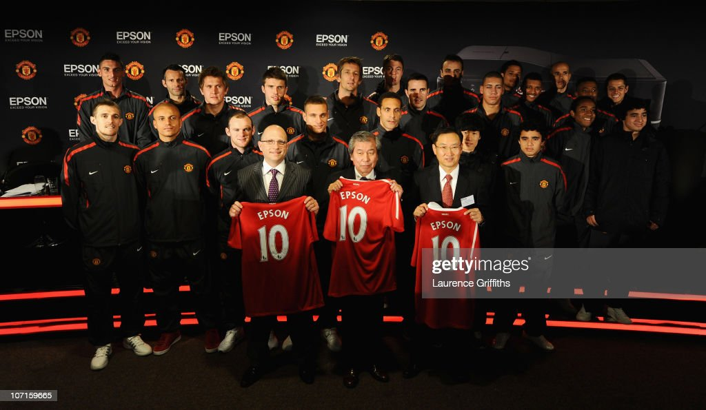 The Manchester United Team pose for a picture with Rob Clark Executive Director of Marketing, Global President Mr Minoru Usui and European President Mr Taba during a Press Conference as Manchester United launch a new sponsorship deal with Epson at Old Trafford on November 26, 2010 in Manchester, England.