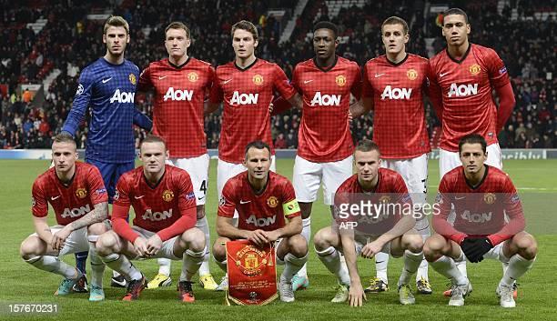 The manchester United team pose for photographers Manchester United's Spanish goalkeeper David de Gea Manchester United's English defender Phil Jones...