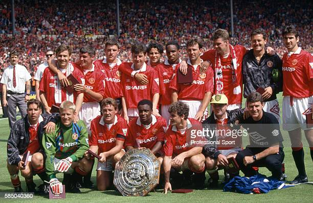 The Manchester United team posing with the trophy following the FA Charity Shield match between Manchester United and Arsenal at Wembley Stadium in...