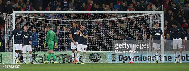 The Manchester United team react to BoKyung Kim of Cardiff scoring their second goal during the Barclays Premier League match between Cardiff City...