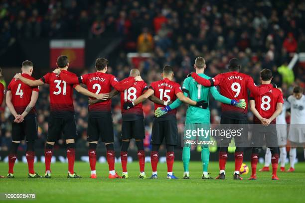 The Manchester United team take part in a minute of silence in tribute to Emiliano Sala prior to the Premier League match between Newcastle United...