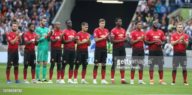The Manchester United team take part in a minute's applause ahead of the Premier League match between Brighton Hove Albion and Manchester United at...