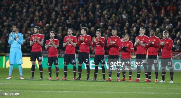 The Manchester United team take part in a minute's applause for Jimmy Armfield ahead of the Emirates FA Cup Fourth Round match between Yeovil Town...