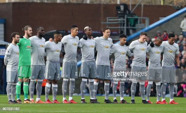 The Manchester United team take part in a minute's silence in memory of Cyrille Regis ahead of the Premier League match between Burnley and...