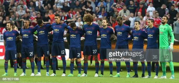 The Manchester United team take part in a minute's silence to honour the victims of the terrorist attack in Manchester on Monday ahead of the UEFA...