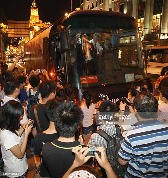 The Manchester United team wait on the team bus after their driver was arrested for a driving misdemeanour en route to a Hublot Charity Dinner and...
