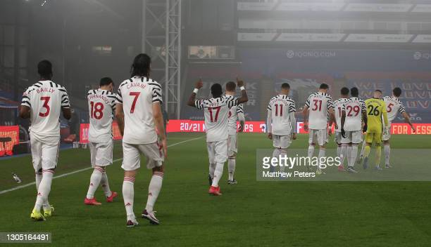 The Manchester United team walk out ahead of the Premier League match between Crystal Palace and Manchester United at Selhurst Park on March 03, 2021...