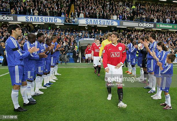 The Manchester United team walk out in a guard of honour ahead of the Barclays Premiership match between Chelsea and Manchester United at Stamford...